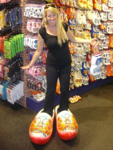 Trying on some wooden shoes in The Netherlands