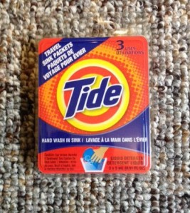 Mini Tide packets for laundry in the sink.