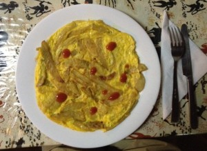 An omelet with homemade fries cooked into it.  Yum!