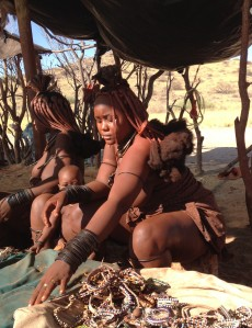 Himba woman selling her crafts.