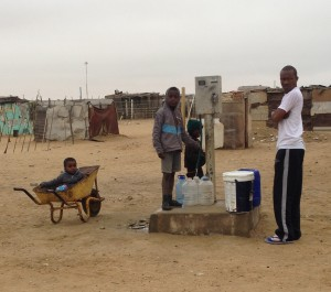 Locals in the poorest area paying for water.